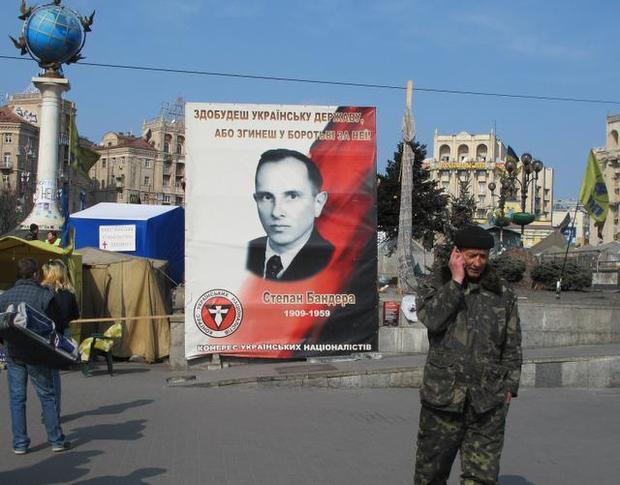 A security volunteer stands in front of a Stepan Bandera banner on Kiev's Independence Square, known as Maidan, on Sunday, March 23, 2014. CLAUDIA HIMMELREICH — MCT http://www.mcclatchydc.com/2014/03/28/222800/hero-or-villain-wwii-partisan.html