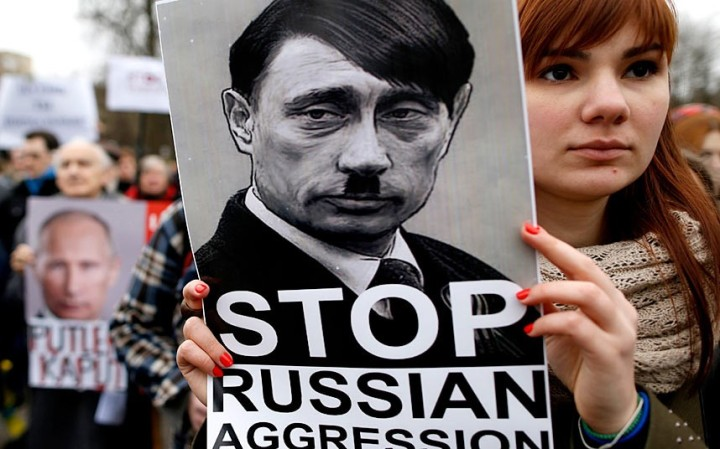 Demonstrators gather outside the Russian Embassy in Vilnius, Lithuania, to protest against Russian intervention in Ukraine. Picture: MINDAUGAS KULBIS/AP http://www.telegraph.co.uk/news/worldnews/europe/ukraine/10670603/Ukraine-in-pictures-Threat-of-war-between-Ukraine-and-Russia.html?frame=2840376