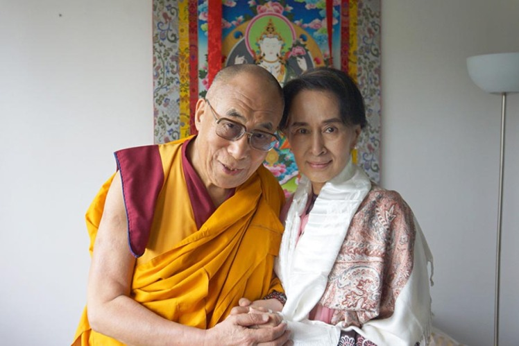 Tibetan spiritual leader the Dalai Lama and Myanmar opposition leader Aung San Suu Kyi pose for a photo during their meeting in Prague, Czech Republic, on 15 September 2013.
