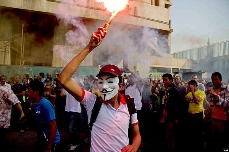 Anti-coup_protester_wearing_Guy_Fawkes_mask_-_demonstration_in_Cairo_6-Oct-2013